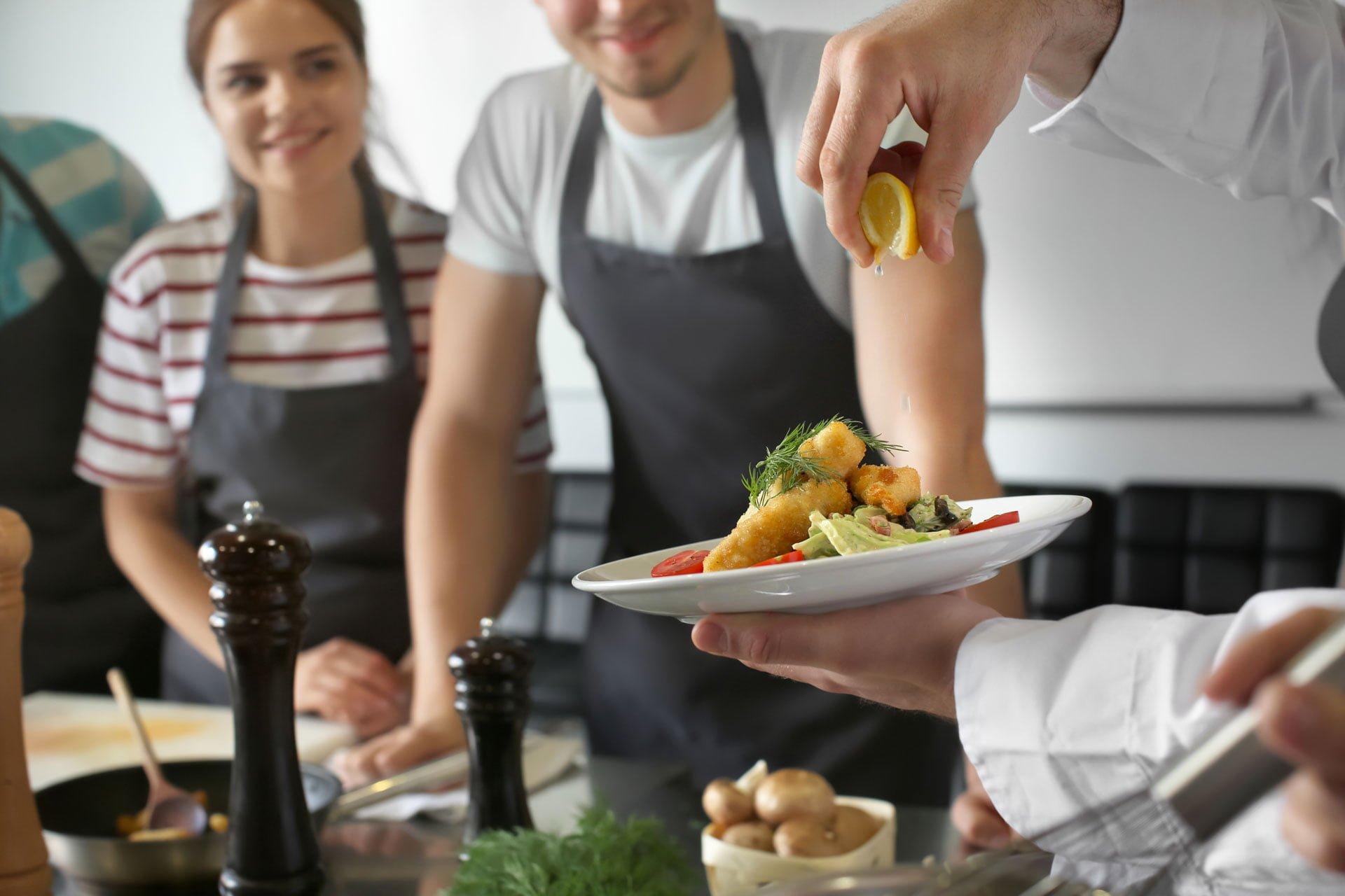 Cook preparing gourmet meal